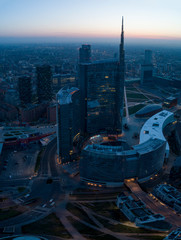 Autocollant pour porte Milan Milan (Italy) city skyline at dawn, aerial view, flying over financial area skyscrapers in Porta Nuova district. Unicredit Tower office building at sunrise.