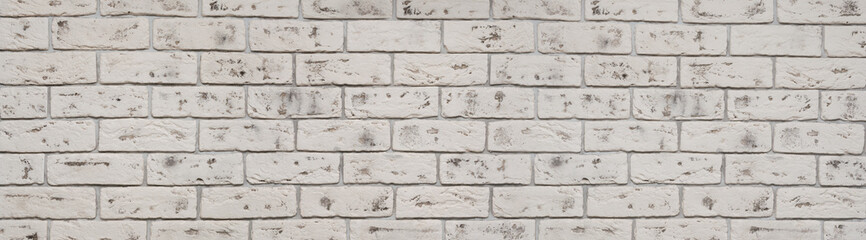 Old white wash brick wall texture. Wide panorama of masonry