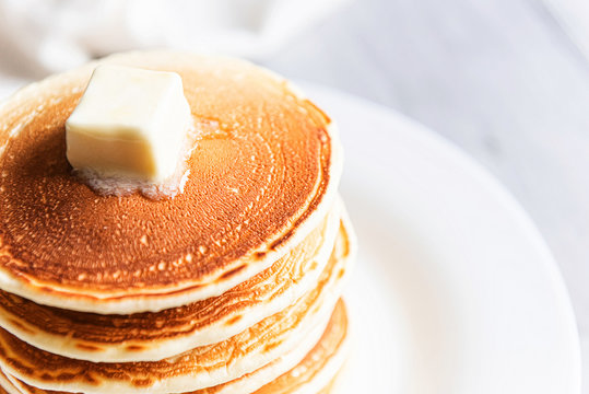 fresh classic pancake stacked in stack on gray background with place for text