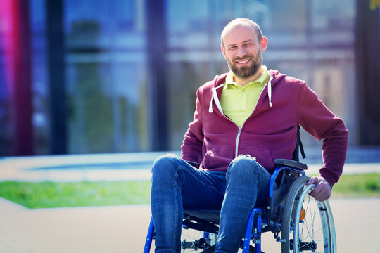happy man on wheelchair