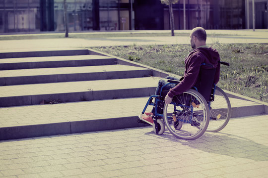 man on wheelchair and steps