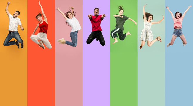 Freedom in moving. Happy young women and men jumping and gesturing against colorful studio background. Runnin girls and guys in motion or movement. Human emotions and facial expressions concept