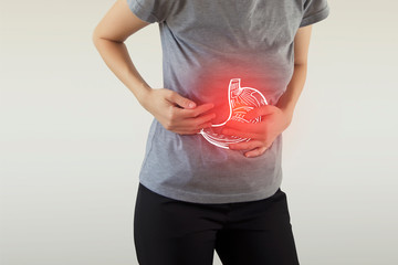 Digital composite of highlighted stomach of woman