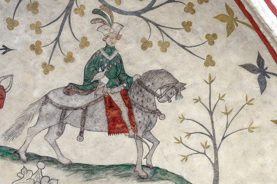 A medieval depiction of a noble young falconer on his horse showing off the latest fashion of the 1400's. The church fresco is located in Odsherred church in Denmark