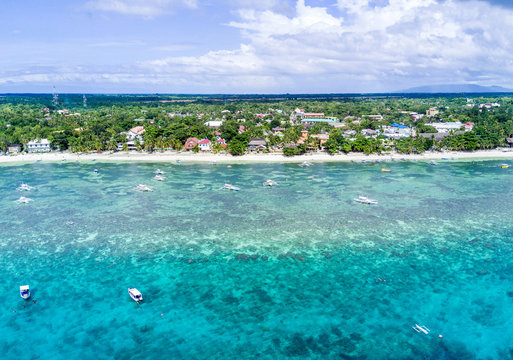 Aerial Drone Panorama Picture of the white sand Alona Beach in Panglao, Bohol in the Philippines