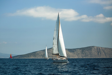 Wall Mural - Sailing yacht boat at the Aegean Sea near Greece coasts. Luxury cruise yachting.