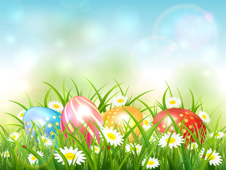 Blue Nature Background with Easter Eggs in Grass