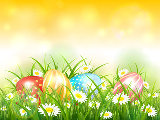 Yellow Nature Background with Easter Eggs in Grass