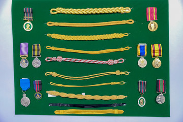 Generic Navy / army uniform badge / accessories at display