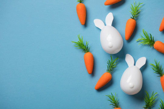 White easter bunny with orange carrots. Easter composition