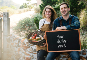 Blackboard Mockup with 2 People with Aprons and a Basket of Vegetables