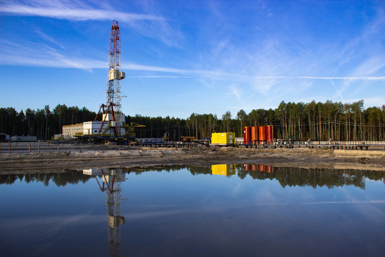 reflection in the water rig in the morning sun in the forest