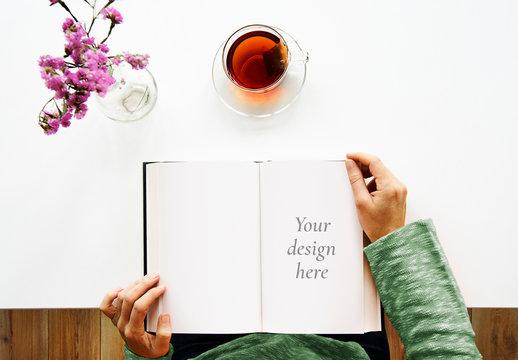 Woman Reading a Book Mockup on Minimalist Table