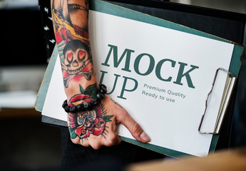 Tattooed Hand Holding Clipboard Mockup