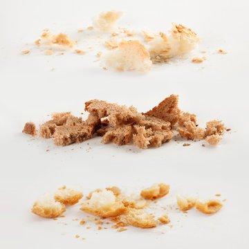 Scattered bread crumbs on white background, top view