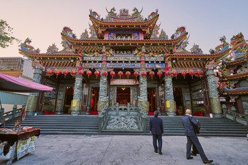 Kaohsiung, Taiwan - December 3, 2018: People come to merit at Cih Ji palace or Bao Sheng Da Di temple in sunset time at Zuoying district, Kaohsiung city, Taiwan.