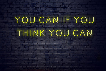 Positive inspiring quote on neon sign against brick wall you can if you think you can