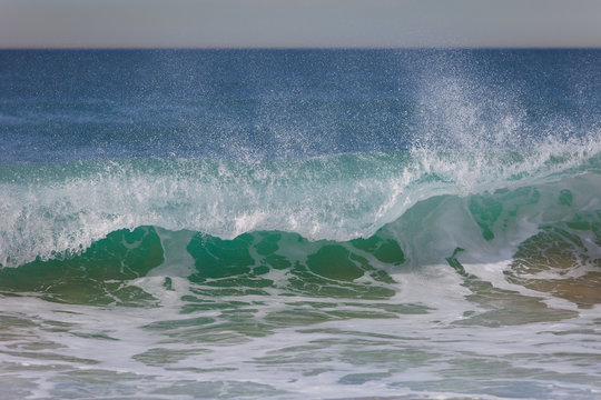 Wave crashing in Hermosa Beach, California