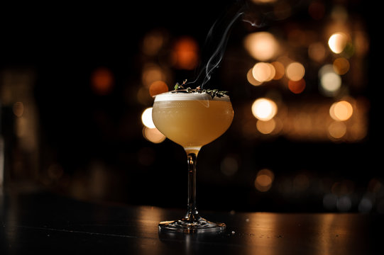 Light brown cocktail on a bar counter
