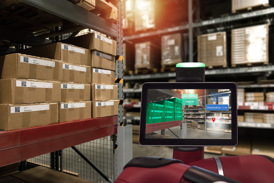 Industrial 4.0 , Augmented reality and smart logistic concept. Robot adviser with AR application for check order pick time in smart factory industry warehouse.