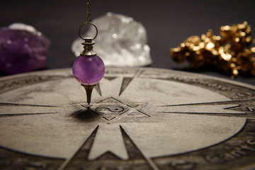 Properties of fortune telling - wooden spiritual chart and pendulum
