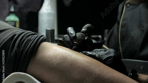 Tattoo Artist Makes A Tattoo On A Man S Hand Stock Footage And