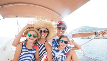 family on sea yacht