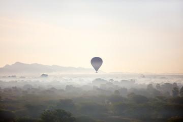 Hot air balloons fly over Bagan