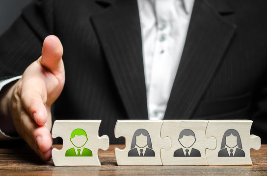 A businessman joins a new employee to the team as its leader. Hiring new employees for the project., teamwork. leader works with the team as a member. increasing efficiency, confidence, communication