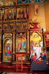 Beautiful iconostasis with ancient icons set in golden frames