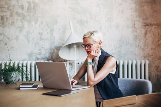 Businesswoman working on laptop at table