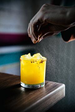 Hands preparing cocktail