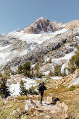 Woman backpacking through the Eastern Sierras in California