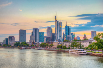 Sunset view of skyscrapers alongside river Main in Frankfurt, Germany