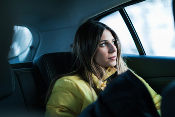 Younger woman thinking and enjoying at travel by car.