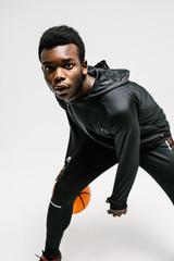 Black man with basketball