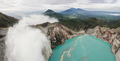 Panoramic photo of the epic landscape, drone flying over the volcanoes and blue lake