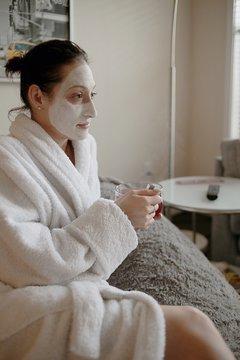 woman doing home facial