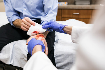 Clinic: Man With Bad Cut On Hand Sees Doctor