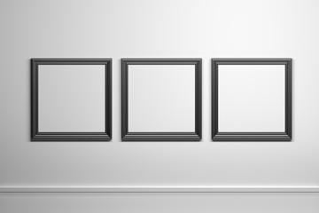 Three black square frames