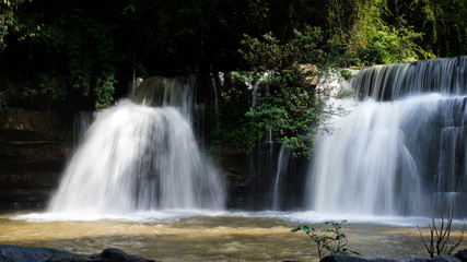 Poster de jardin Cascades Waterfalls during the rainy season The red soil and water is flowing at Si Dit waterfall , Phetchabun in Thailand.