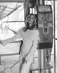 Young woman by train ticket machine