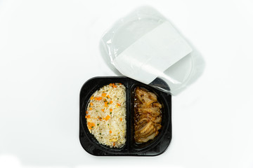 Top view Ready to eat chilled fried rice with chicken in plastic box isolated on white background