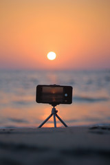 A mobile iphone camera in a tripod of beach location