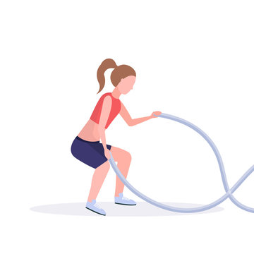 sporty woman doing crossfit exercises with battle rope girl training in gym cardio workout healthy lifestyle concept flat white background full length