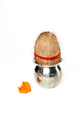 Picture of kalash with coconut and marigold flower for navratri festival. Isolated on the white background.