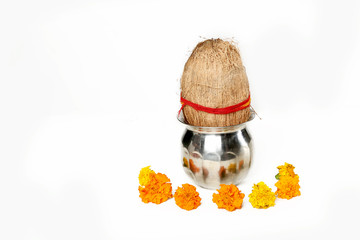 Portrait of kalash with coconut and marigold flower for navratri festival. Isolated on the white background.
