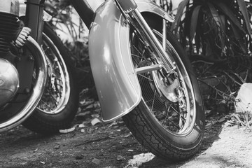 Black and white photo part vintage scooter close up