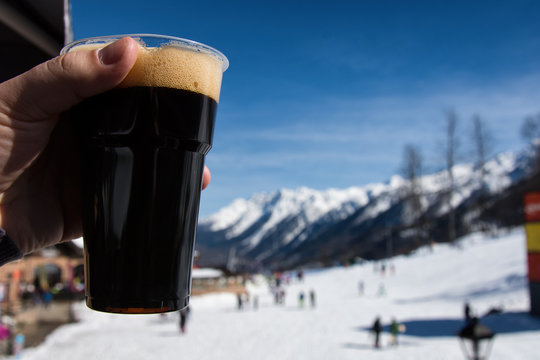 The mountains and beautiful vacation. Dark beer.