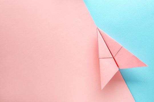 Paper plane on color background. Travel concept